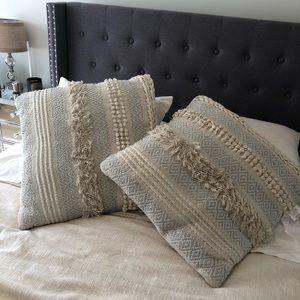 Cream textured throw pillows w blue/silver accents